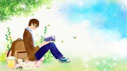 들판에 앉아서 책을 읽는 남자의 모습