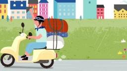 도시 도로 위를 달리는 오토바이를 탄 남자의 모습