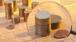 확대한 동전과 금융 신문