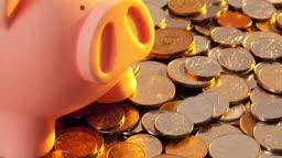 동전 위 분홍 돼지저금통