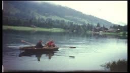 Family in rowboat (8 mm film)