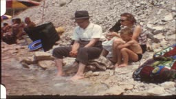 Family with grandpa on the lake (8 mm film)