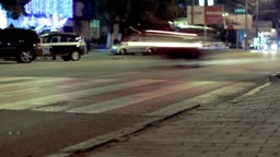pedestrian crossing on the streets of the city at night. timelapse.