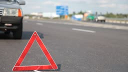 triangle indicating car damage on the road.