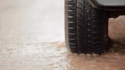 car tire in a stream of of rainwater