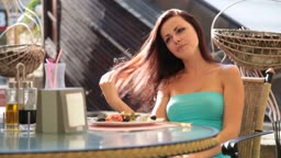 young brunette Woman has dinner  In coffee shop