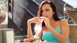beautiful woman has dinner in the cafe