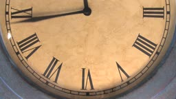 Extra fast time lapse of a clock with roman numerals, loopable