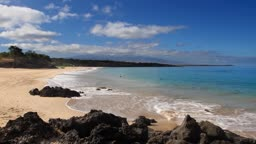 Time lapse of Hapuna Beach in Hawaii on a beautiful day, mountain in the background