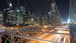 A time lapse of Manhattan, overlooking Brooklyn Bridge at night. Time Lapse.
