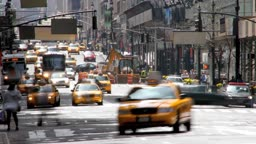 Time lapse of busy city traffic and pedestrians on a street in New York