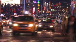 Time lapse of city traffic and pedestrians at night, shot in Times Square, New York City