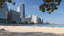 View of the Northern Chicago skyline and Lake Michigan from the sandy beach near Navy Pier on a sunny day
