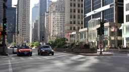 Time lapse of traffic and pedestrians at a red light on Michigan Avenue in Chicago