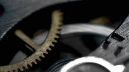 Close up on rotating cogs of a stopwatch