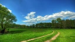 spring landscape with a rural road. HDR timelapse.