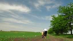 A family cycling in the summer time