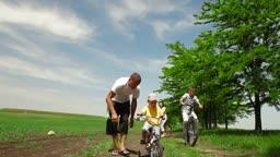 A family  bike ride down a country lane