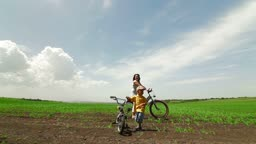 Active young family enjoying bike ride in the country , Wide shot