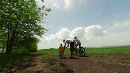 Family with children having a weekend excursion on their bikes