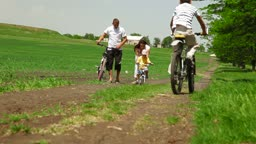 Young Family Riding Bikes