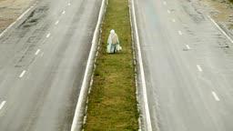 Pedestrian On Dividing Line Under The Rain