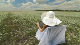 Young Woman Using Digital Tablet In Nature