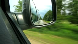 Traveling on the highway. Look in the mirror of a moving car.