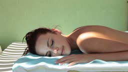 Beautiful woman with closed eyes relaxing outdoor at spa resort