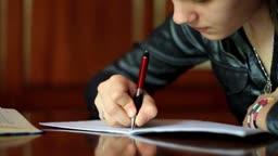 Student girl doing homework.