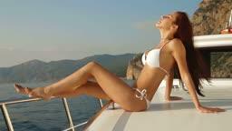 Bikini Woman Posing on Luxury Yacht