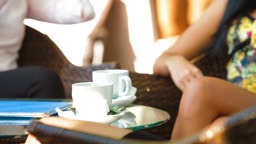 Three women enjoy a coffee break at outdoor cafe