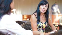 Female Friends Informal Conversation in Outdoor Cafe