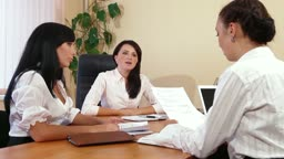 Business Women Working Together in a Meeting