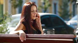 Young attractive woman talking on the cell phone in downtown