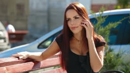 Attractive woman talking on the cell phone in downtown