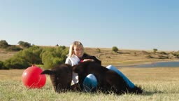 Woman Having Fun With Their Newfoundland Dogs Outdoor