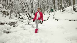 Teenage Girl Playing Snowballs in Winter Forest