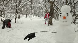 Funny Teenage Couple Enjoying in Snow and Winter