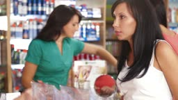 Sales Person Assisting Female Shopper in Choice of Beauty Care Products
