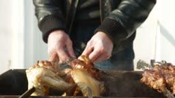 Man preparing shish kebab at garden party, closeup