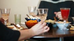 Friends or family having dinner at home.
