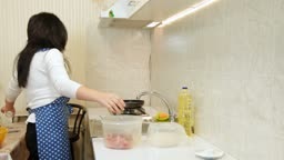 Woman Baking At Home, Salting Mincemeat