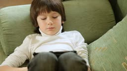 Child Playing Computer Games On Tablet Pc At Home