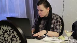 A Young And Confident Business Woman Using Her Laptop.