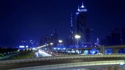 Time Lapse Of Dubai Night Against The Burj Khalifa. HD Video.