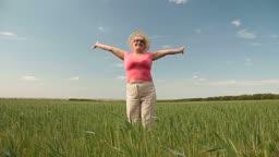 Joyful senior woman enjoying retirement on the nature