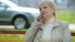 Active Senior Lady On The Phone Outdoors
