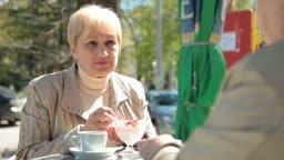 Senior Women Enjoying Dessert At Outdoor Cafe