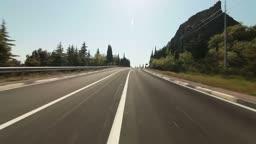 Driving car on a mountain road along the coast of the Black Sea. Yalta, Crimea